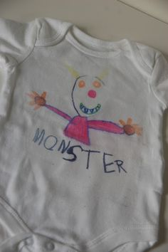 LOVE THIS IDEA! Pack of white onesies, fabric crayons, and iron-on transfers. Each big brother or sister creates a unique onesie design for new baby.