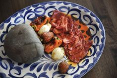 Republica's Caliente Rock with strips of raw Wagyu beef to cook on the heated rock