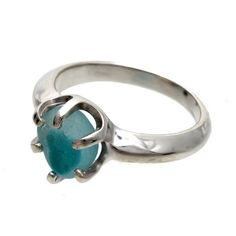 A stunning piece of mixed aqua sea glass from Seaham England and the site of Victorian era glass factories is set in a solid sterling silver 6 prong ring.