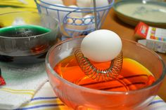 Color eggs using a whisk as a egg dipper.  Helpful for kids to use.