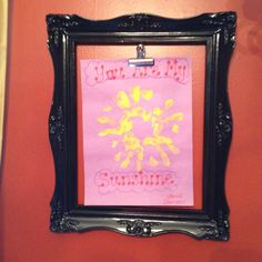 A different way to display treasures: Junk store frame spray painted and a clip
