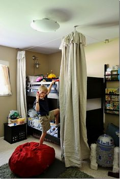 love the bunk bed fort, light, and bookshelves- love seeing the front covers of books displayed!