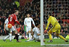 Manchester United 2 Swansea 1: a brilliant winner from Wayne Rooney as he uses his left foot to flick the ball past Swansea goalkeeper  Lukasz Fabianski (right) during the final 15 minutes