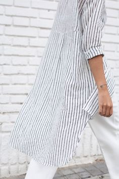 Super cute striped summer shirt! Love the loose fit. Find a similar one here: http://asos.do/bCeg2F and http://asos.do/zRAfr9
