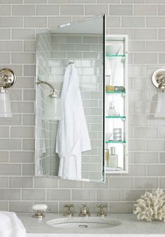 It does look great !! Grey glass tile. Soothing. Would look awesome in our bathroom!