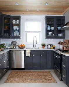 Dark cabinet, white tile kitchen, this is my dream kitchen. I don't need a big one to be happy, this is perfect black and white kitchen