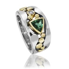 River Pebbles Ring with Green Tourmaline Gold & Stone Ring. Created by Rona Fisher $2,700.00   ||  Tapered ring with river pebbles motif. In solid 14 karat white gold with solid 18 karat yellow gold pebbles and bezels. Light patina accentuates the contrast between the warm and cool gold colors. Fine-quality 6mm Brazilian green tourmaline trillion and 3mm round (0.10 ct.) fine-quality diamond…