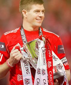 Steven Gerrard with the Carling Cup trophy. Captain Fantastic is a LEGEND