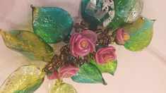 If your lady is more drawn to glass, local artist Carolyn Baum creates beautiful, unique earrings and necklaces made with hand-blown glass leaves and flowers. Prices start at $42 and range to $380.