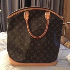 Authentic large Louis Vuitton  lockit handbag Authentic Louis Vuitton handbag. Only 1 owner since purchased in 2006 . When not in use always kept in dust bag . Well taken care of always ! More pics  and date code available to serious buyer ,this bag is hard to find !!!! The only one on poshmark , style icon Louis Vuitton Bags Satchels