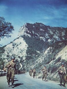 Infantrymen of the 88th Division march along picturesque mountain highway #64 leading to Bologna. Little opposition was encountered in this sector.