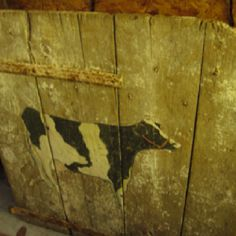 Salvaged barn door with hand painted cow