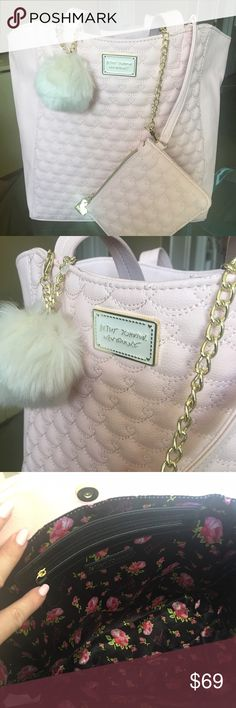 """END OF SUMMER SALEBetsy Johnson NWTPriceFirm Super cute and chic brand new with tags Betsy Johnson baby pink large tote with extra little quilted wristlet and cream Pom Pom accessory. Plenty of room for all your necessities, interior zip pocket, snap closure. Measurements are: 16"""" length x 13"""" width. Such a great bag!❤️ Betsey Johnson Bags Totes"""