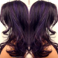 Purple highlights on dark plum hair by Robin!