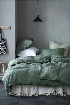Modern Scandinavian bedroom in shades of green.