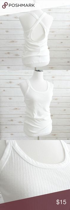 """Free People White Cross Back """"West Village"""" Tank Free People white ribbed cotton tank with a cross back and a long length.  The tank has thick cross back straps.  The straps are not adjustable.  Condition: NWOT Type: Top Style: Tank Style Name: West Village Brand: Free People Size: L Color: White Approx. Measurement: 34"""" Chest, 17"""" Length (Length measured from the back) Materials: 100% Cotton  DD0.8:201802231213:005:89FP Free People Tops Tank Tops"""