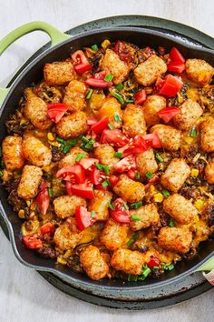 This tater tot casserole recipe incorporates lean ground beef, fresh tomatoes, shredded zucchini, onions, corn, cheddar cheese, and tater tots to create the ultimate comfort food recipe that incorporates loads of summer vegetables. Whether you're eating this zucchini recipe with the family on the weekend or as a quick and easy 30-minute weeknight dinner, it's a great choice for a casserole recipe.#zucchinirecipes #casserolerecipes #summerrecipes #30minutedinners #quickandeasyrecipes