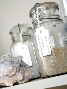 Treasure vacation memories by bringing home sand and storing it in vintage jars. More ways to display collectibles: http://www.bhg.com/decorating/home-accessories/tips/ways-to-display-collectibles/?socsrc=bhgpin081812displaysand#page=2