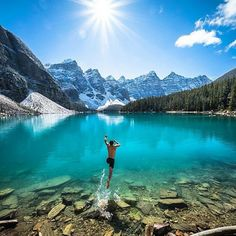 TAKE THE LEAP! Go travel! Jump in that freezing cold lake climb that mountain get that sunburn tell that story make that friend experience the ups conquer the downs... most importantly live outside your comfort zone! Good things happen in your comfort zone AMAZING things happen outside of it!  @chrisburkard knows...here he is leaping into an ice cold Moraine Lake Canada