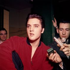 Elvis Presley being interviewed backstage at the Memorial Auditorium in Ottawa, Canada before his evening concert on Wednesday, April 3, 1957. | Listen to an interview Elvis gave Mac Lipson from CKOY radio: https://www.youtube.com/watch?v=ACiGWwD-X8A | See more: http://www.elvisinfonet.com/spotlight_elvis_in_ottawa.html