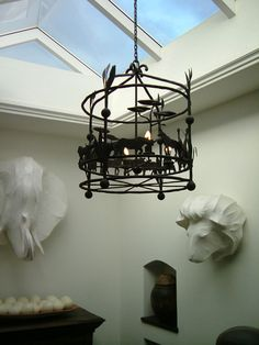Iron casting lighting, skylight, big five sculptures in Hout Bay Manor, Cape Town