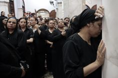 IN MOURNING: Coptic Christians attended a funeral Monday in Giza, Egypt, for four victims from one family—including two girls—who were kille...