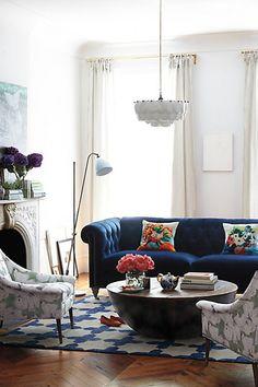 blue capitoné sofa