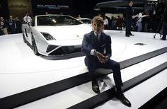 CEO of Italian car maker Automobili Lamborghini, poses next to a Gallardo LP570-4 Squadra Corse car