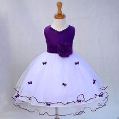 *Material: Elegant Satin Poly / Polyester Tulle / Crinoline Netting / Satin Lining / Butterflies *Color: White / with PURPLE Sash / Scattered