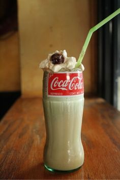 Bar Pilar's Cuba Libre Float - weighs in with vanilla ice cream, rum, Mexican coke, a Southern Comfort-soaked cherry, and — wait for it — homemade absinthe whipped cream