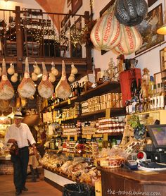 """Row upon row of prosciutto legs loiter from the ceilings – you can choose which part you'd like your meat sliced from – one side is better for eating as an anti-pasto with cantaloupe melon or fig, the other good for sandwiches or cooking"" - ""Bologna – La Grassa La Gusto"" by @Suzanne Courtney @TheTravelBunny"
