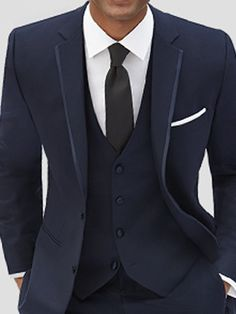 Moores Joseph Abboud Navy Blue suit with cream shirt, cream tie and cream handkerchief. Post ceremony and for the boys.