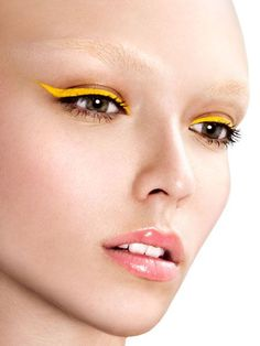 If you consider yourself to be a bold beauty aficionado, then perhaps you've peeped the latest vivid color to star front and center on lids. If not, here's a little secret: yellow eye makeup is having a major moment.