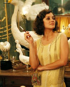If you don't think Marion Cotillard is gorgeous then go fall down somewhere where I cannot find you!