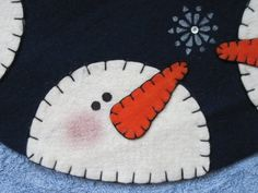 """This 15"""" circle of snowmen is handcrafted with felt and warm & natural batting.  Makes a cozy table centerpiece.No sewing machine required -- just a simple blanket stitch!This pattern includes a color photo, detailed instructions, full-size templates, & a supplies list.The finished product may be sold for fun or profit, but please give Adeline's Crafts credit for the design.My original patterns are copyrighted & cannot be copied, resold, or altered."""