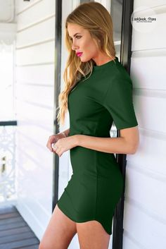 Most Wanted // Flaunt your curves and parade your pins in this dark green curved-hem bodycon dress.
