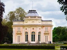 """The Château de Bagatelle is a small neoclassical palace with a French landscape garden in the Bois de Boulogne in the 16th arrondissement of Paris. """"Bagatelle"""" means a trifle, or little decorative nothing. In 1775, the Comte d'Artois, Louis XVI's brother, purchased the property from the prince de Chimay. The Comte engaged the neoclassical architect François-Joseph Bélanger to design the building that remains in the park today."""