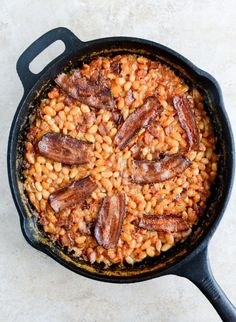 Toss some bacon in with your baked beans for a heavenly hint of flavor. | side dish recipe