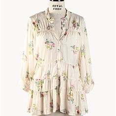 Three Tiered Floral Silk Blouse. I'd wear it with jeans, colorful cowboy boots, and my hair in a messy braid as I gathered daisies from the field. Just kidding about the daisies.
