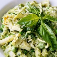 Pesto Pasta Salad with creamy pesto dressing, sweet peas, artichoke hearts, and penne pasta.