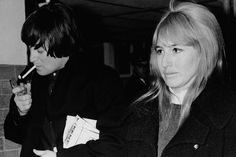 George Harrison' Affair with Maureen | John Lennon lights up a cigarette as he and his wife, Cynthia, arrive ...