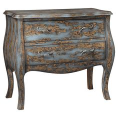 A hand-painted distressed finish and scrolling pulls highlight this chic bombe chest, brimming with antiqued style for your home.  P...