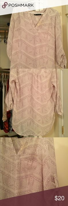 Gray pattern tunic Gray patterned tunic. Size zero at maurices. It was wore a few times. Good condition. Maurices Tops Tunics