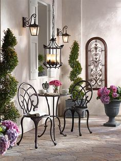 Outdoor bistro set with vintage style outdoor pendant and wall lights and…