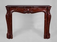 Beautiful antique Louis XV style fireplace made out of Red Griotte marble during the century. The generously curved shapes of this fireplace are characteristic of the Louis XV style , as is the leafy shell that adorns the center of the frieze. Fireplace Inserts, Fireplace Mantels, Saint Ouen, Marble Floor, Entryway Tables, Flooring, Paris, Beautiful, Antiques