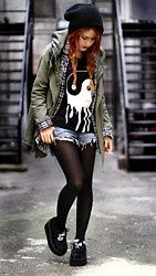 Military green jacket on any black and white outfit compliments itself and sets off hair color