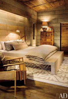 In the master bedroom of a Colorado residence designed by William Sofield, the walls are made of salvaged granite.