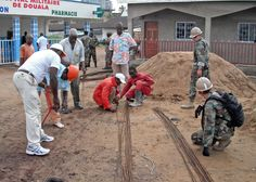 the us navy in cameroon walking on a projet in Douala cameroon