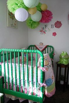 paper lanterns above the crib. They came from my baby shower decor! Flowers on wall are from baby shower gift bags. : ) #nursery