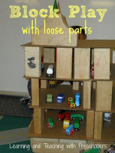 Adding cardboard to the loose parts shelf.